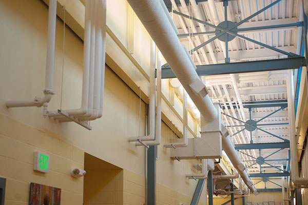 Commercial facility with HVAC and process piping systems
