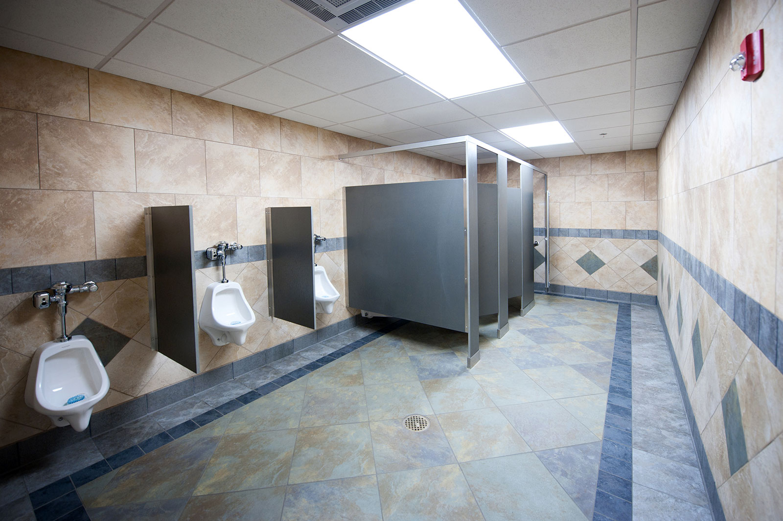 Restroom with toilets and urinals at a commercial facility