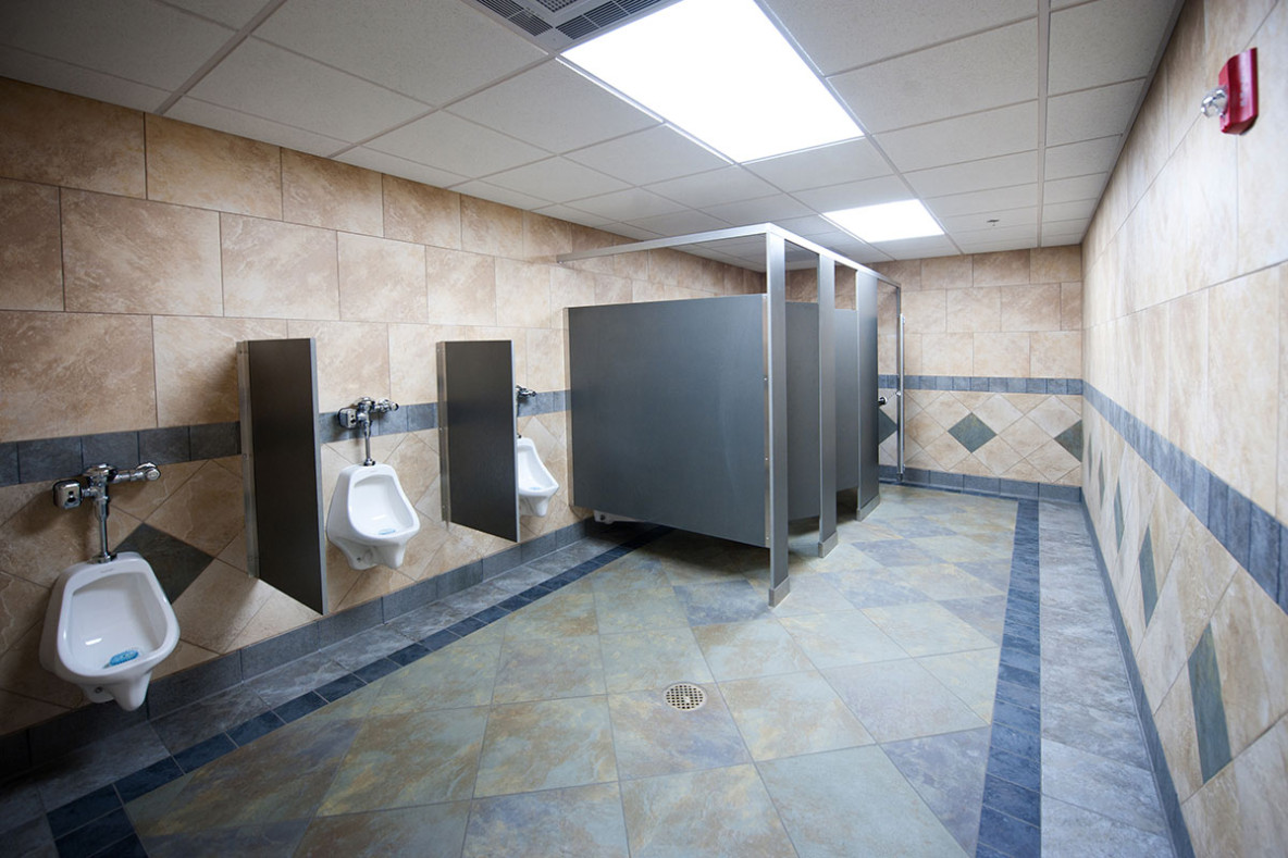 Commercial restroom plumbing including toilets and urinals